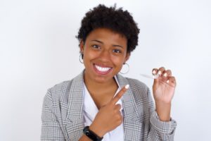 woman knows the benefits of Invisalign